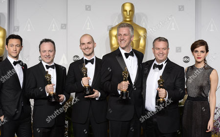 Visual Effects Artists Tim Webber (2-l) Chris Lawrence (3-l) David Shirk (3-r) and Neil Corbould (2-r) Hold Their Oscars For Best Achievement in Visual Effects For 'Gravity' While Standing with Us Actor Joseph Gordon-levitt (l) and British Actress Emma Watson (r) in the Press Roomduring the 86th Annual Academy Awards Ceremony at the Dolby Theatre in Hollywood California Usa 02 March 2014 the Oscars Are Presented For Outstanding Individual Or Collective Efforts in Up to 24 Categories in Filmmaking United States Hollywood