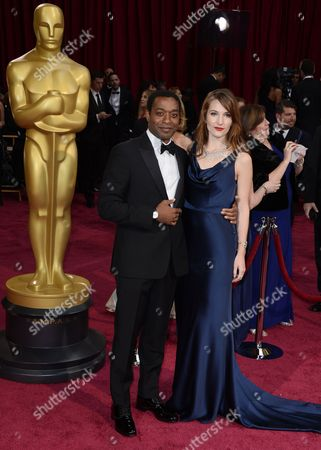 British Actor Chiwetel Ejiofor (l) and His Partner Shari Mercer (r) Arrive For the 86th Annual Academy Awards Ceremony at the Dolby Theatre in Hollywood California Usa 02 March 2014 the Oscars Are Presented For Outstanding Individual Or Collective Efforts in Up to 24 Categories in Filmmaking United States Hollywood