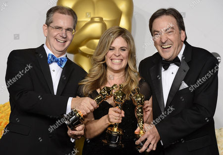 (l-r) Filmmakers Chris Buck Jennifer Lee and Peter Del Vecho Hold Their Oscar For Best Animated Feature Film For 'Frozen' in the Press Room During the 86th Annual Academy Awards Ceremony at the Dolby Theatre in Hollywood California Usa 02 March 2014 the Oscars Are Presented For Outstanding Individual Or Collective Efforts in Up to 24 Categories in Filmmaking United States Hollywood
