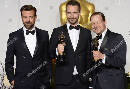 Filmmakers Anders Walter (c) and Kim Magnusson (r) Hold Their Oscars For Best Live Action Short Film For 'Helium' While Standing with Us Actor Jason Sudeikis (l) in the Press Room During the 86th Annual Academy Awards Ceremony at the Dolby Theatre in Hollywood California Usa 02 March 2014 the Oscars Are Presented For Outstanding Individual Or Collective Efforts in Up to 24 Categories in Filmmaking United States Hollywood