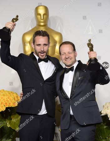 Filmmakers Anders Walter (l) and Kim Magnusson (r) Hold Their Oscars For Best Live Action Short Film For 'Helium' in the Press Room During the 86th Annual Academy Awards Ceremony at the Dolby Theatre in Hollywood California Usa 02 March 2014 the Oscars Are Presented For Outstanding Individual Or Collective Efforts in Up to 24 Categories in Filmmaking United States Hollywood
