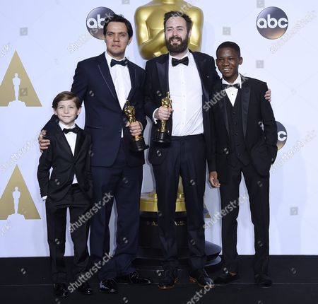 Shawn Christopher Ogilvy (2-l) and Benjamin Cleary (2-r) Hold the Oscar For Best Live Action Short Film For 'Stutterer' As They Pose with Presenters Jacob Tremblay (l) and Abraham Attah (r) in the Press Room During the 88th Annual Academy Awards Ceremony at the Dolby Theatre in Hollywood California Usa 28 February 2016 United States Hollywood