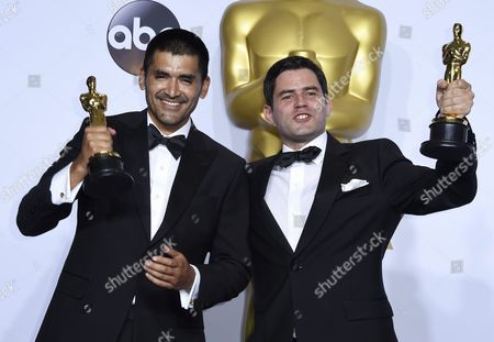Gabriel Osorio (l) and Pato Escala Hold the Oscar For Best Animated Short Film For 'Bear Story' in the Press Room During the 88th Annual Academy Awards Ceremony at the Dolby Theatre in Hollywood California Usa 28 February 2016 United States Hollywood