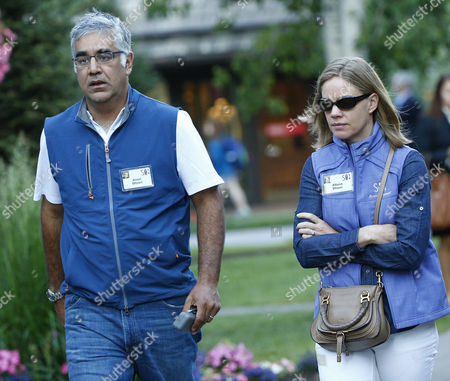 Stock Photo of Aneel Bhusri (l) Founder and Ceo of Workday and Allison Bhusri (r) Arrive at the Allen and Company 32nd Annual Media and Technology Conference in Sun Valley Idaho Usa 10 July 2014 the Event Brings Together the Leaders of the World's of Media Technology Sports Industry and Politics United States Sun Valley