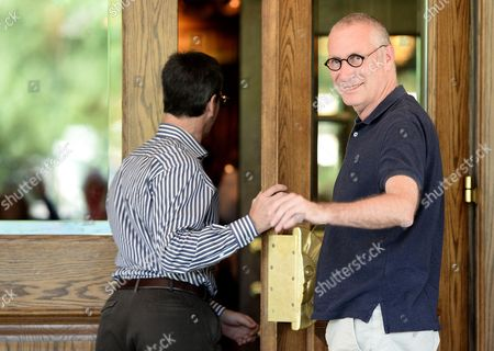 Stock Photo of Tom Staggs (l) Chairman of the Walt Disney Company's Parks and Resorts Division and John Skipper (r) President of Espn Inc and Co-chairman of Disney Media Networks Arrive For Allen and Company 31st Annual Media and Technology Conference in Sun Valley Idaho Usa 09 July 2013 the Event Which Opens on 10 July 2013 Brings Together the Leaders of the Worlds of Media Technology Sports Industry and Politics United States Sun Valley