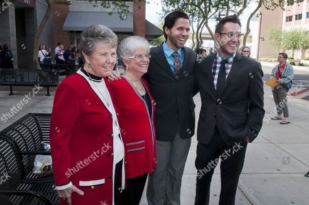Stock Photo of (l-r) Nelda Majors and Karen Bailey; David Larance and Kevin Patterson Become the First Couples Granted Marriage Licenses at the Maricopa Country Clerk's Office in Phoenix Arizona Usa 17 October 2014 Hours After the Ninth Circuit Court of Appeals Struck Down Arizona's Band on Same Sex-marriage Couples Lined Up at the Clerk's Office As Soon As the Announcement of the Court Decision was Made and a Number of Officiants Stationed Themselves Outside the Office to Perform Marriage Ceremonies Immediately After the Licenses Were Issued United States Phoenix