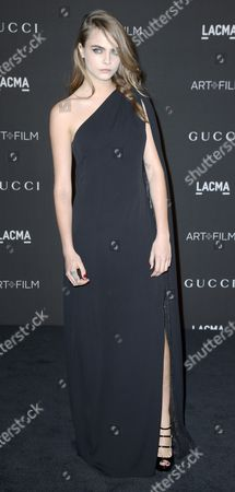 British Model Cara Delevingne Arrives For the 2014 Lacma Art + Film Gala at the Los Angeles County Museum of Art (lacma) in Los Angeles California Usa 01 November 2014 the Event Honored Us Artist Barbara Kruger and Us Director Quentin Tarantino United States Los Angeles