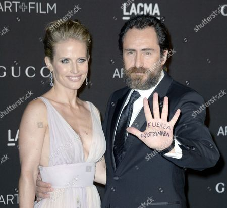 Mexican Actor Demian Bichir (r) Holds Up His Hand with the Words 'Fuerza Ayotzinapa' Written on It As He Arrives with Actress Stefanie Sherk (l) For the 2014 Lacma Art + Film Gala at the Los Angeles County Museum of Art (lacma) in Los Angeles California Usa 01 November 2014 the Message on His Hand Means 'Stay Strong Ayotzinapa' and It is in Reference to the 43 Missing Students From the Town of Ayotzinapa who Were Last Seen on 26 September in Iguala in the Mexican State of Guerrero the Event Honored Us Artist Barbara Kruger and Us Director Quentin Tarantino United States Los Angeles