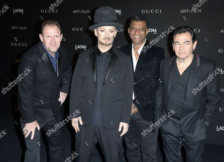 British Singer-songwriter Boy George (2-l) and Members of the British Band Culture Club Arrive For the 2014 Lacma Art + Film Gala at the Los Angeles County Museum of Art (lacma) in Los Angeles California Usa 01 November 2014 the Event Honored Us Artist Barbara Kruger and Us Director Quentin Tarantino United States Los Angeles