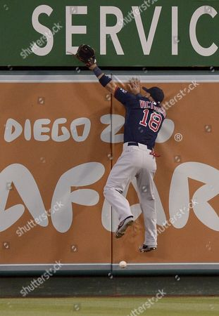 Boston Red Sox Right Fielder Shane Victorino Leaps But is not Able to Catch a Deep Fly Ball Off the Bat of Anaheim Angels J B Shuck in the Third Inning of Play at Angel Stadium in Anaheim California Usa 05 July 2013 United States Anaheim