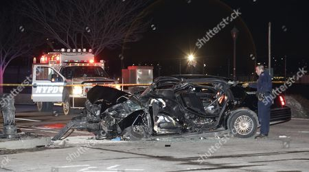 A New York City Policeman (r) Stands Next to the Crashed Livery Cab where Us 60 Minutes Correspondent Bob Simon was Traveling in New York New York Usa 11 February 2015 Simon 73 a Passenger in a Livery Cab Traveling South on 12th Ave at W 30 St Died on 11 February when the Cab Rear-ended a Mercedes-benz Driven by a 23-year-old Man and Then Slammed Into a Median Around 6:45 Pm Est United States New York