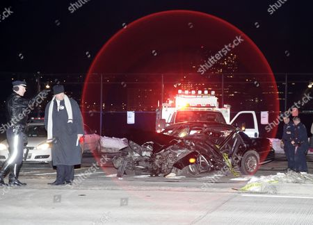 A New York City Policeman (l) Stands Next to the Crashed Livery Cab where Us 60 Minutes Correspondent Bob Simon was Traveling in New York New York Usa 11 February 2015 Simon 73 a Passenger in a Livery Cab Traveling South on 12th Ave at W 30 St Died on 11 February when the Cab Rear-ended a Mercedes-benz Driven by a 23-year-old Man and Then Slammed Into a Median Around 6:45 Pm Est United States New York
