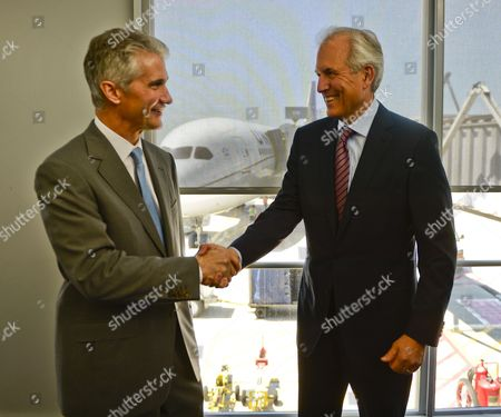 United Airlines Ceo Jeff Smisek (l) and Boeing Ceo Jim Mcnerney (r) Shake Hands After They Arrived on a Boeing 787 Dreamliner (c) Operated by United Airlines at O'hair International Airport in Chicago Illinois Usa 20 May 2013 the Fleet of Planes was Cleared to Fly Again in the Us After Being Grounded by Authorities on 17 January 2013 Due to the Threat of Fire Caused by Faulty Batteries Repairs to the Battery Systems Include Greater Space Between Cells and Encasement in Steel Boxes Should the Batteries Cause a Fire United States Chicago