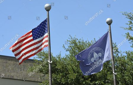 The Us National Flag (l) and the Boy Scouts of America Flag Fly Outside the Boy Scouts of America Headquarters in Irving Texas Usa 28 July 2015 the Boy Scouts of America (bsa) Said on 27 July That the 105-year-old Organization Would Allow Openly Gay Adult Leaders and Employees For the First Time After a Vote by Its National Executive Board the Resolution Which Passed with 79 Per Cent of Board Approval is Effective Immediately United States Irving