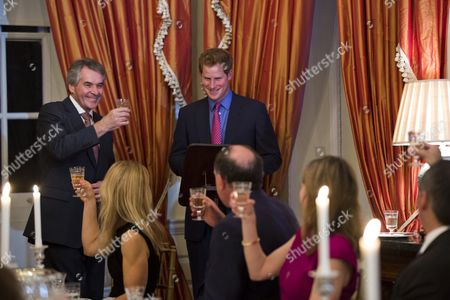 Ambassador to the Us Sir Peter Westmacott (l) Toasts Britain's Prince Harry (c) at a Dinner at the Ambassador's Residence in Washington Dc Usa 09 May 2013 Prince Harry Kicked Off His Visit to the Us with Two Days in the Nation's Capial United States Washington