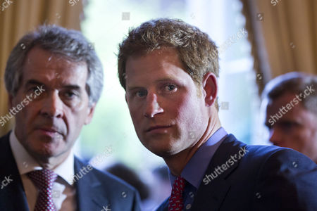 Britain's Prince Harry (c) Along with British Ambassador to the Us Sir Peter Westmacott (l) Scan the Crowd at a Reception in the Prince's Honor at the Ambassador's Residence in Washington Dc Usa 09 May 2013 Prince Harry Kicked Off His Visit to the Us with Two Days in the Nation's Capital United States Washington