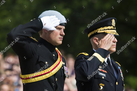 Britain's Prince Harry (l) Along with Major General Michael Linnington (r) Commanding General of the Military District of Washington Salute After Laying a Wreath at the Tomb of the Unknowns at Arlington National Cemetery in Arlington Virginia Usa 10 May 2013 Prince Harry Kicked Off His Visit to the Us with Two Days in the Nation's Capitol United States Arlington