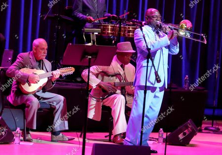 Jesus Aguaje Ramos (r) on the Trombone and Barbarito Torres (l) on the Aoud and Other Members of the Cuban Band Buena Vista Social Club Perform During Their 'Adios Tour' (goodbye Tour) at Knight Concert Hall in Miami Florida Usa 22 October 2015 Orquesta Buena Vista Social Club Has Been Touring the Globe in Different Forms and Combinations Since 1997 They Go on Tour One Final Time with a Series of Concerts and Related Cultural Events That Will Celebrate the Ochestras Storied Journey As Ambassadors For Cuban Music United States Miami