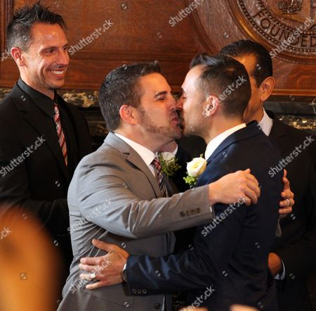 Same Sex Couple Paul Katami (c) and Jeff Zarrillo (r) Kiss After Getting Married at Los Angeles City Hall in Los Angeles California Usa 28 June 2013 After California's Proposition 8 Banning Gay Marriage was Struck Down by the the 9th Circuit Court of Appeals the Supreme Court Over-turned the Prop 8 Ban on Same-sex Marriages on 26 June United States Los Angeles