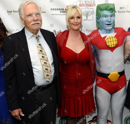 Cnn Founder Ted Turner (l) and Us Environmental Activist and Honoree Erin Brockovich (c) Pose with Captain Planet Upon Their Arrival For the Captain Planet Foundation Benefit Gala at the Georgia Aquarium in Atlanta Georgia Usa 06 December 2013 the Event Recognizes Individuals For Their Environmental Stewardship United States Atlanta