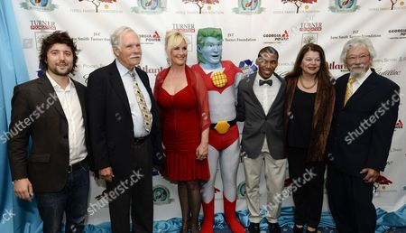 Stock Photo of (l to R) Honoree Tom Szaky Cnn Founder Ted Turner Environmental Activist Erin Brockovich Captain Planet Honoree Charles Orkbon Iii Tara Cullis and Environmental Activist David Suzuki Pose For a Picture Upon Their Arrival For the Captain Planet Foundation Benefit Gala at the Georgia Aquarium in Atlanta Georgia Usa 06 December 2013 the Event Recognizes Individuals For Their Environmental Stewardship United States Atlanta