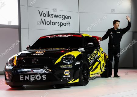 Driver Tanner Foust Waves As He is Introduced After Driving a Volkswagen Grc Beetle Onto the Stage During the Media Preview For the Chicago Auto Show at Mccormick Place in Chicago Illinois Usa 06 February 2014 the Show Opens to the Public on 07 February Volkswagen Has Teamed with Andretti Motorsports to Enter the Red Bull Global Rallycross Series For 2014 United States Chicago