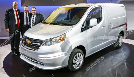 General Motors Global Chief Marketing Officer Tim Mahoney (r) General Motors Vice President of Us Fleet and Commercial Vehicles Ed Peper (l) and General Motors Chief Engineer For Trucks Jeff Luke (c) Pose with the 2015 Chevrolet City Express Light Van After Its Introduction During the Media Preview For the Chicago Auto Show at Mccormick Place in Chicago Illinois Usa 06 February 2014 the Show Opens to the Public on 07 February United States Chicago