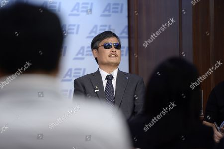 Chinese Civil Rights Activist Chen Guangcheng (c) Responds to a Question at the Event '25 Years After Tiananmen: a Discussion with Chen Guangcheng' at the American Enterprise Institute in Washington Dc Usa 03 June 2014 a Blind Self-taught Lawyer That Fled House-arrest in Rural China Chen Guangcheng Spoke Ahead of the 25th Anniversary of the Crackdown on Democracy Activists That Took Place in Beijing 04 June 1989 United States Washington