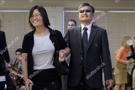 Chinese Civil Rights Activist Chen Guangcheng (r) and His Wife Weijing Yuan (l) Arrive For the Event '25 Years After Tiananmen: a Discussion with Chen Guangcheng' at the American Enterprise Institute in Washington Dc Usa 03 June 2014 a Blind Self-taught Lawyer That Fled House-arrest in Rural China Chen Guangcheng Spoke Ahead of the 25th Anniversary of the Crackdown on Democracy Activists That Took Place in Beijing 04 June 1989 United States Washington