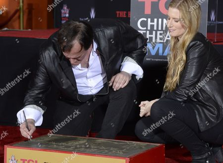 Stock Image of Us Director Quentin Tarantino (l) Signs His Name in Cement As Tcl Chinese Theatre Ceo Alwyn Hight Kushner (r) Looks on During a Cement Handprint and Footprint Ceremony Honoring Him at the Tcl Chinese Theatre in Hollywood California Usa 05 January 2016 Tarantino's Latest Movie 'The Hatefeful Eight' is in Theaters Now United States Hollywood