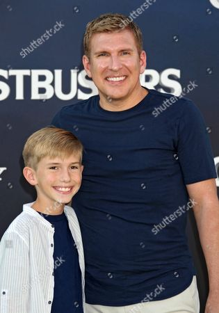 Stock Photo of Us Actor Todd Chrisley (r) and His Son Grayson Chrisley (l) Arrive For the Premiere of the Film 'Ghostbusters' at the Tcl Chinese Theatre Imax Laser in Hollywood California Usa 09 July 2016 United States Los Angeles