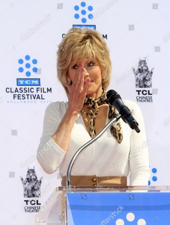Us Actress Jane Fonda Reacts As She Delivers a Speech at Her Hand and Footprints Ceremony of Us Actress Jane Fonda Outside Tcl Chinese Theatre in Hollywood California Usa 27 April 2013 Fonda Joins a Select Group of Industry Luminaries who Have Been Honoured by Having Their Hand and Footprints Encased in Cement Panels That Pave the Forecourt of the Historic Theatre Her Prints Will Be Next to Those of Her Father Henry Fonda United States Hollywood