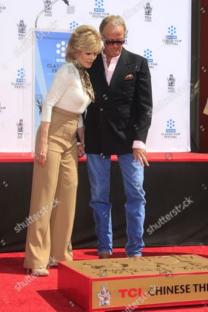 Us Actress Jane Fonda (l) with Her Brother Actor Peter Fonda (r) at Her Hand and Footprints Ceremony Outside Tcl Chinese Theatre in Hollywood California Usa 27 April 2013 Fonda Joins a Select Group of Industry Luminaries who Have Been Honoured by Having Their Hand and Footprints Encased in Cement Panels That Pave the Forecourt of the Historic Theatre Her Prints Will Be Next to Those of Her Father Henry Fonda United States Hollywood