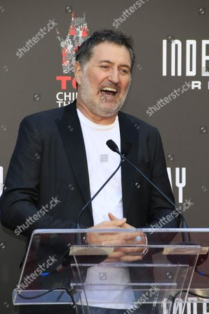 Austrian Composer Harald Kloser Speaks at a Ceremony Honoring German Director Roland Emmerich with His Hand and Foot Prints in Cement at the Tcl Chinese Theatre Imax in Hollywood California Usa 20 June 2016 United States Los Angeles
