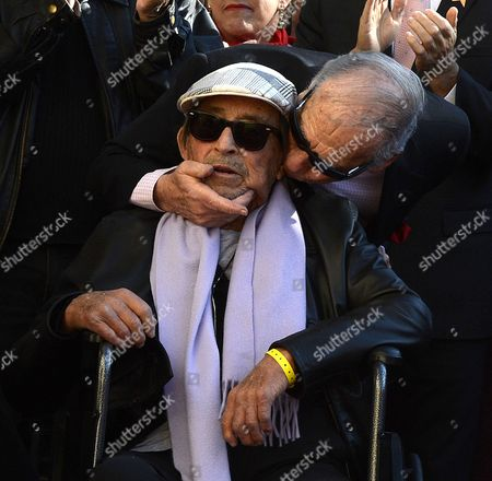 Stock Photo of Us Director Mel Brooks (r) Gives a Kiss to Us Actor/director Paul Mazursky (l) During a Ceremony Honoring Him with a Star on the Hollywood Walk of Fame in Hollywood California Usa 13 December 2013 United States Hollywood