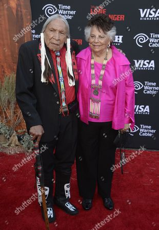 Native American Actor Saginaw Grant (l) Arrives For 'The Lone Ranger' Premiere at Disneyland in Anaheim California Usa 22 June 2013 Woman at Right is Unidentified United States Anaheim