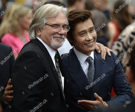 Korean Actor Byung-hun Lee (r) Poses with Us Director Dean Parisot (l) As They Arrive For the Premiere of the Movie 'Red 2' in Westwood California Usa 11 July 2013 United States Westwood