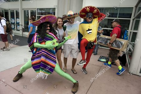 Stock Photo of Mike Phillips (l) and Sean Craig (r) From San Diego Pose As Psycho Mariachi Players For Photographs with Convention Goers (c) on the Second Day of Comic-con 2015 in San Diego California Usa 10 July 2015 United States San Diego