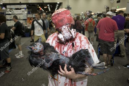 Mike Erwin From Chula Vista California Holds a Puppet Cat From the Movie Reanimator on the Second Day of Comic-con 2015 in San Diego California Usa 10 July 2015 United States San Diego