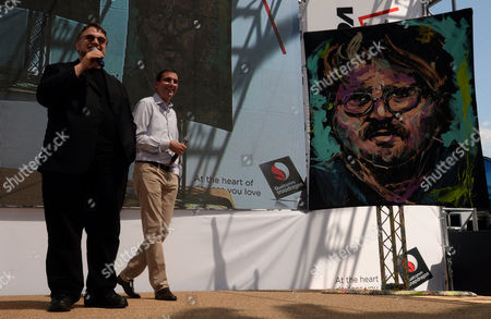 Mexican Director Guillermo Del Toro (l) is Presented with a Painting of Himself by David Garibaldi During a Presentation by Qualcomm of His Upcoming Movie 'Pacific Rim' at the E3 (electronic Entertainment Expo) in Los Angeles California Usa 12 June 2013 the E3 Expo Introduces New Games and Gaming Devices and is an Anticipated Annual Event Among Gaming Enthusiasts and Marketers Man in Center is a Qualcomm Snapdragon Executive United States Los Angeles