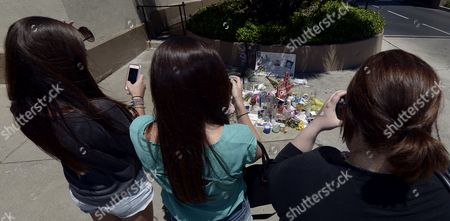 Tourists Stop to Photograph a Shrine For Dead Canadian Actor Cory Monteith Outside the Gates of Paramount Pictures in Los Angeles California Usa 17 July 2013 Monteith who Starred in the Television Show 'Glee' Died of Mixed Drug Toxicity a Combination of Heroin and Alcohol Monteith was Found Dead in His Hotel in Vancouver on 13 July 2013 the Actor Had Struggled with Drugs and Alcohol Abuse For Years United States Los Angeles