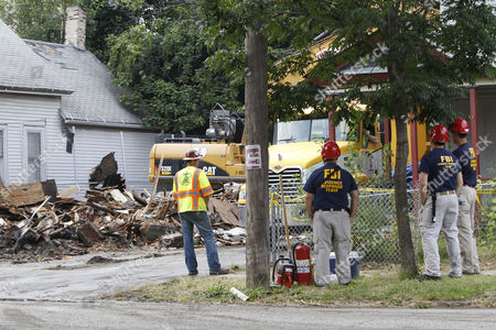 Fbi Evidence Response Team Members Monitor the Demolition of the House of Convicted Kidnapper and Rapist Ariel Castro on Seymour Avenue in Cleveland Ohio Usa 07 August 2013 Amanda Berry Gina Dejesus and Michelle Knight Were Found Alive on 06 May 2013 After Having Been Held Hostage For Nearly 10 Years in Ariel Castro's House Castro who Plead Guilty to 937 Charges was Sentenced to Life Imprisonment Plus a Thousand Years with No Chance of Parole on 01 August 2013 United States Cleveland