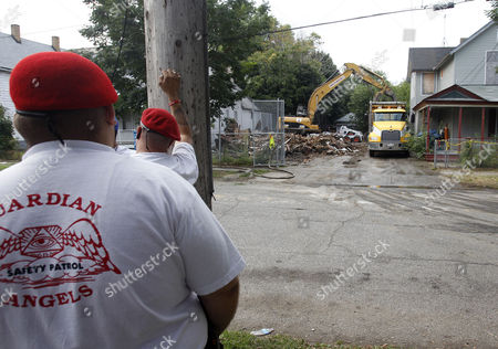 Members of the Guardian Angels a Non-profit Unarmed Citizen Crime Patrol Organisation Stand Watch Over the Demolition of the House of Convicted Kidnapper and Rapist Ariel Castro on Seymour Avenue in Cleveland Ohio Usa 07 August 2013 Amanda Berry Gina Dejesus and Michelle Knight Were Found Alive on 06 May 2013 After Having Been Held Hostage For Nearly 10 Years in Ariel Castro's House Castro who Plead Guilty to 937 Charges was Sentenced to Life Imprisonment Plus a Thousand Years with No Chance of Parole on 01 August 2013 United States Cleveland