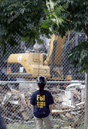 An Fbi Worker Watches the Demolition of the House of Convicted Kidnapper and Rapist Ariel Castro on Seymour Avenue in Cleveland Ohio Usa 07 August 2013 Amanda Berry Gina Dejesus and Michelle Knight Were Found Alive on 06 May 2013 After Having Been Held Hostage For Nearly 10 Years in Ariel Castro's House Castro who Plead Guilty to 937 Charges was Sentenced to Life Imprisonment Plus a Thousand Years with No Chance of Parole on 01 August 2013 United States Cleveland