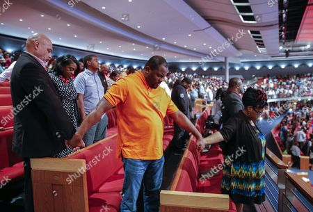 Stock Picture of People Joins Hands As Bishop T D Jakes Hosts 'Conversations with America' Town Hall at the Potter's House in Dallas Texas Usa 10 July 2016 Five Dallas Police Officers Died After an Ambush Assault by a Gunman During a Protest Rally in Dallas on 07 July United States Dallas