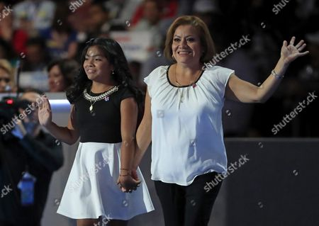 Eleven-year-old Karla Ortiz (l) and Her Mother Francisca Ortiz Wave As They Take the Stage on the First Day of the Democratic National Convention at the Wells Fargo Center in Philadelphia Pennsylvania Usa 25 July 2016 the Four-day Convention is Expected to End with Hillary Clinton Formally Accepting the Nomination of the Democratic Party As Their Presidential Candidate in the 2016 Election United States Philadelphia