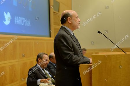 Stock Photo of Us Federal Reserve Board Chairman Ben Bernanke (r) Deliver Remarks in Front of Economist Lawrence Summers (l) at an Economic Forum on 'Policy Responses to Crises' During the Fourth Annual Jacques Polak Research Conference at the International Monetary Fund (imf) in Washington Dc Usa 08 November 2013 United States Washington