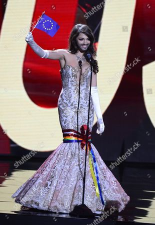 Stock Image of Miss Austria Amina Dagi Sports a Mustache and Beard Reminding of Austria's Eurovision Song Contest Winner Conchita Wurst As She Waves the European Union Flag As She Competes in National Costume Contest During Filming For the 2016 Miss Universe Pageant at the Planet Hollywood Hotel & Casino in Las Vegas Nevada Usa 16 December 2015 the Miss Universe Pageant Will Take Place on 20 December 2015 United States Las Vegas