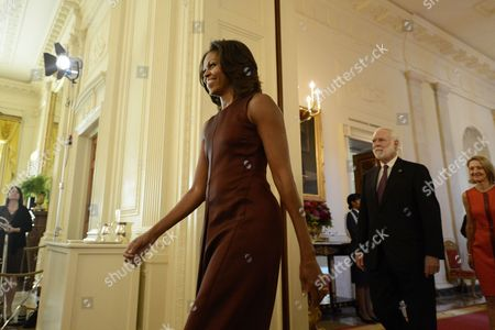 Stock Image of Us First Lady Michelle Obama (c) Walks Into the East Room with Secretary of the Smithsonian Institution Wayne Clough (2-r) and Director of the Smithsonian's Cooper-hewitt National Design Museum in New York Caroline Baumann (r) For a Luncheon in Honor of the Winners of the 2013 National Design Awards at the White House in Washington Dc Usa 20 September 2013 the Awards Are Organized by the Smithsonian's Cooper-hewitt National Design Museum with High School Students From New York and Washington Dc United States Washington