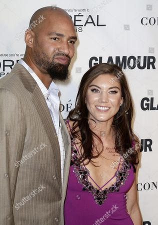 Us Soccer Goalkeeper Hope Solo (r) and Former American Football Tight End Jerramy Stevens (l) Pose For Photos During the 25th Annual Glamour Women of the Year Awards at Carnegie Hall in New York New York Usa 09 November 2015 United States New York